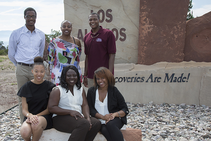 Michelle Lee (back row, center), program manager for ROSES, gathers at the entry to Los Alamos with some of the program's 2016 interns.