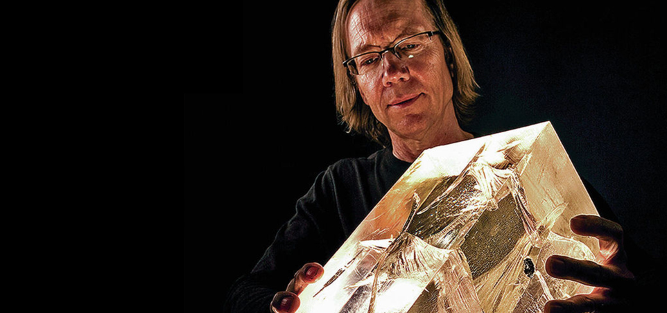 The author holds a cracked sample of acrylic used to study damage effects linked to faulting. Johnson hopes Laboratory research can lead to better forecasting of earthquakes someday. (Photo: LANL)