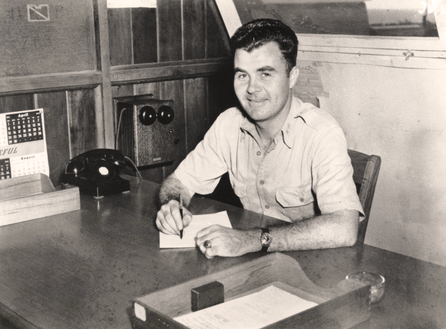 Photo of Paul Tibbets at a desk.