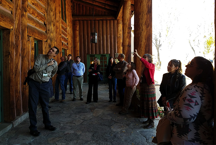 Heather McClenahan tours conference attendees around Fuller Lodge.
