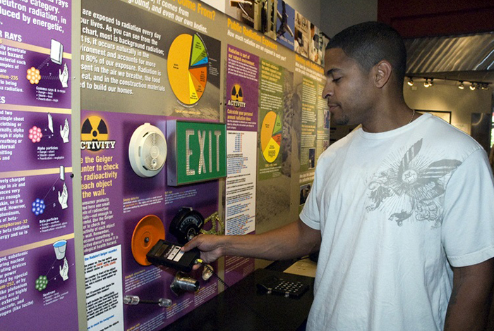 Visitor looking at Radiation exhibit