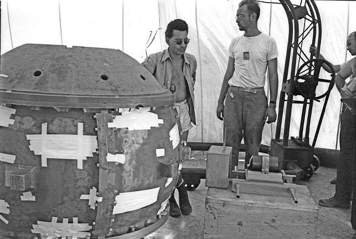 The Gadget is shown here before its successful detonation during the Trinity test on July 16, 1945. This plutonium implosion-style device was the precursor to the Fat Man weapon deployed above Nagasaki on Aug. 9, 1945. Information related to these world-changing events are part of the collections in the National Security Research Center, the Lab's classified library.